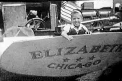 "Cap'n Fatty at 3-years-old at the transom of the boat he grew up on, ""Elizabeth"""